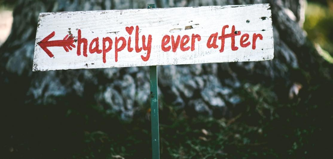 "A handwritten sign saying ""happily ever after"""