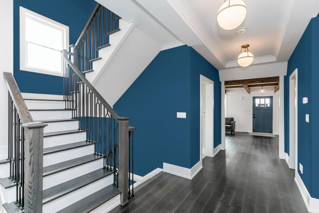blue walls throughout entry and staircase