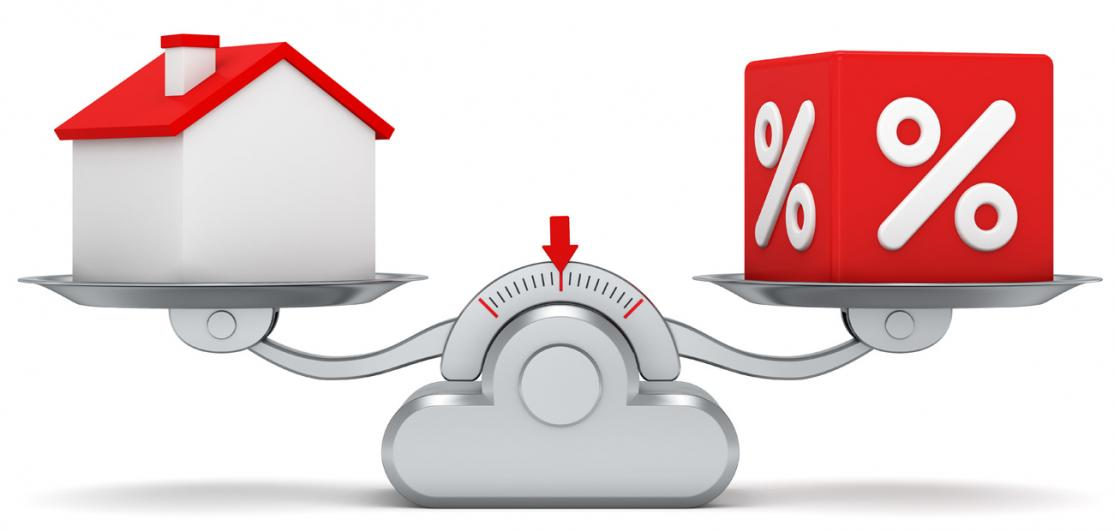 scale with home and interest rate symbol