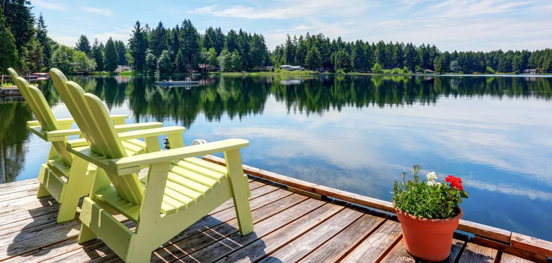 two chairs on deck facing lake
