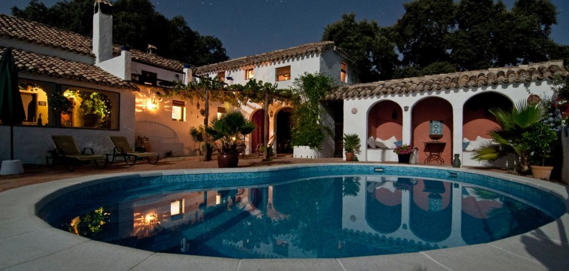 A mansion with a reflecting pool