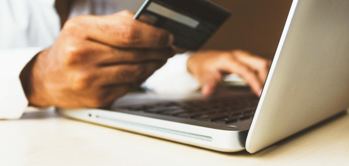 Holding a credit card while using a computer