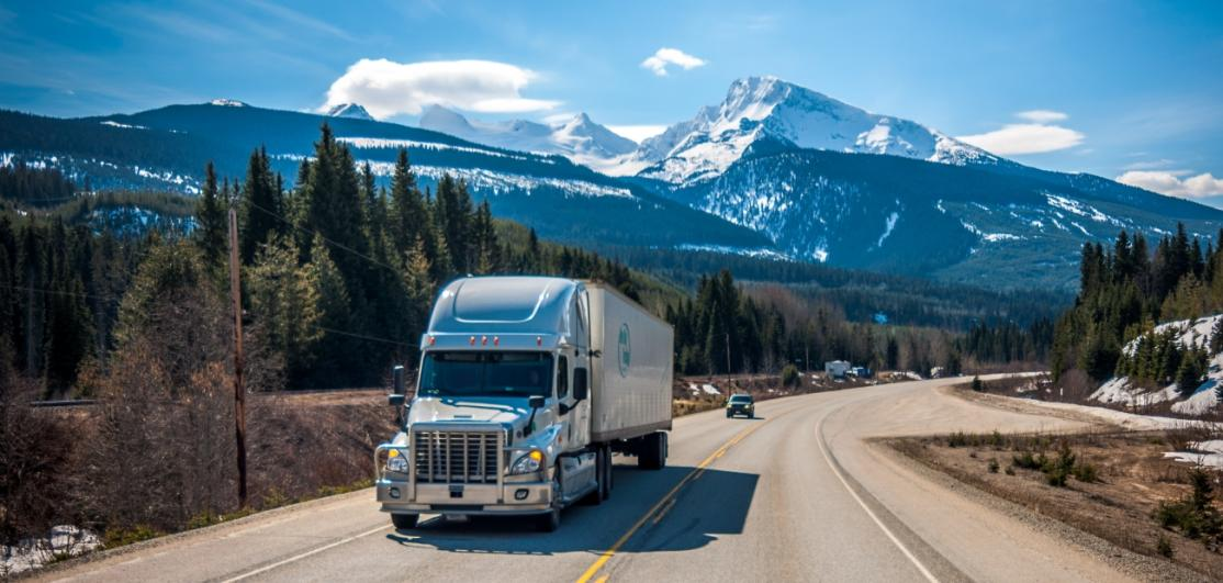 A moving truck on a scenic highway