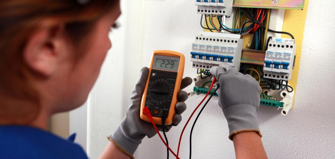 electrician working on box