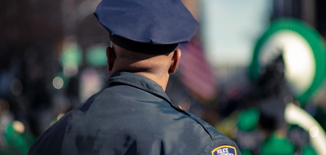 A police officer shown from the back