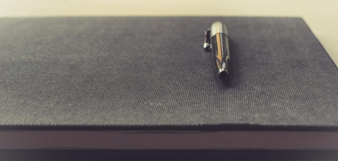 A pen on a planning book