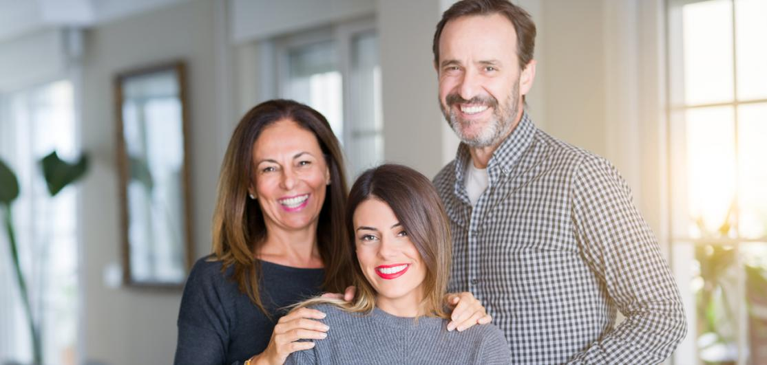 young adult daughter with parents