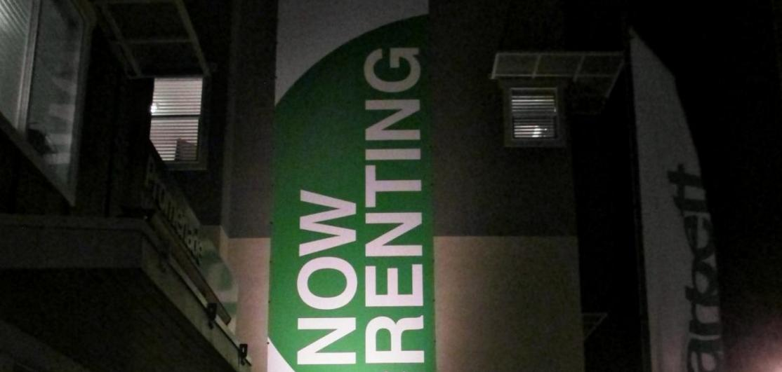 """A sign reading """"Now Renting"""""""