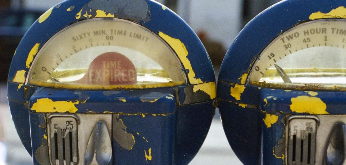 """Old parking meters, flag says """"Time Expired"""""""