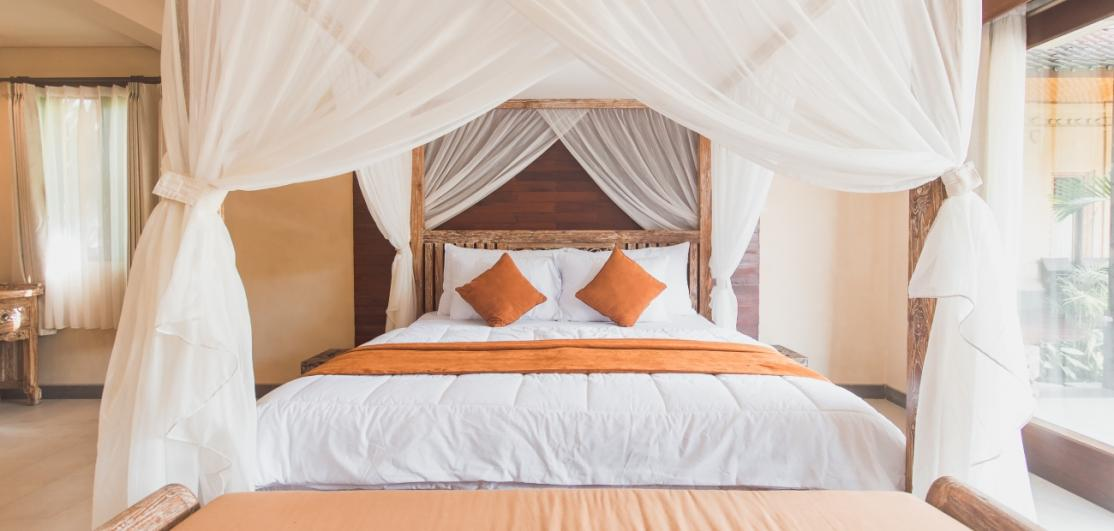 A large bed under a canopy