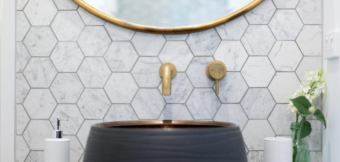 bathroom with brass fixtures and accents