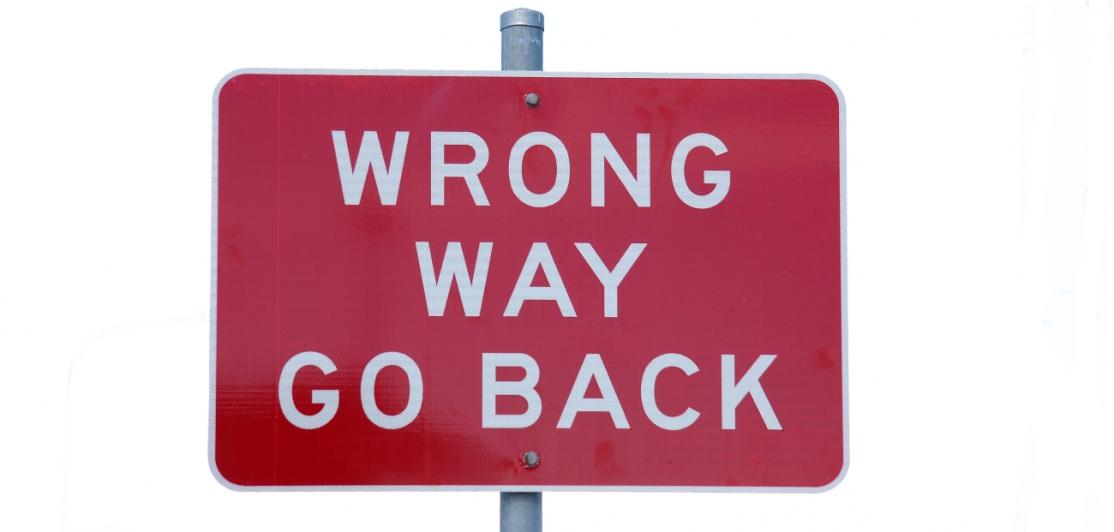 "Sign reads ""Wrong way, go back"""