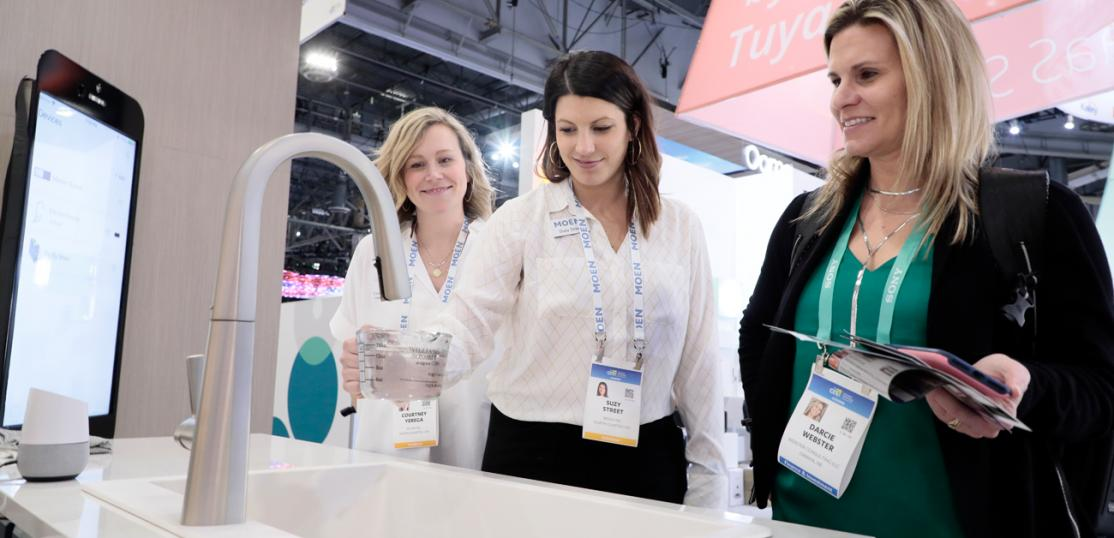 Attendees at the 2020 Consumer Electronics Show test new technology products for the home, such as a smart kitchen sink.