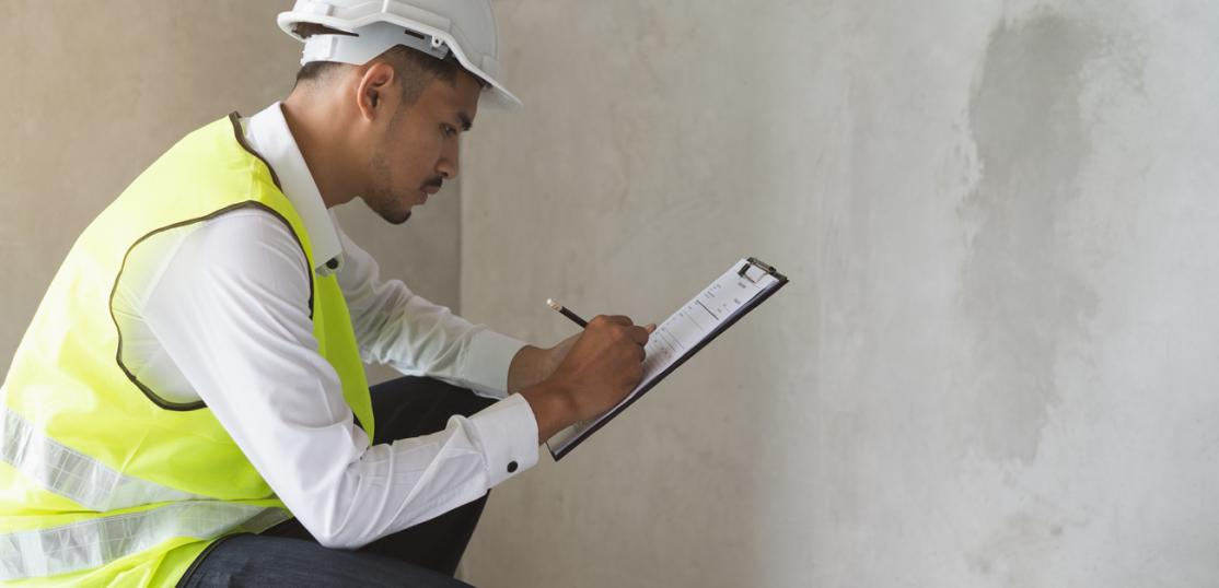 inspector filling out report at jobsite