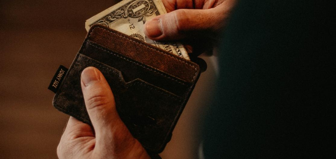 A person leafing through a wallet