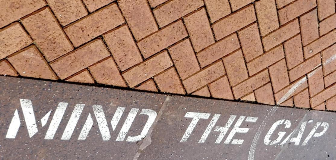 """sign reading """"Mind the Gap"""""""