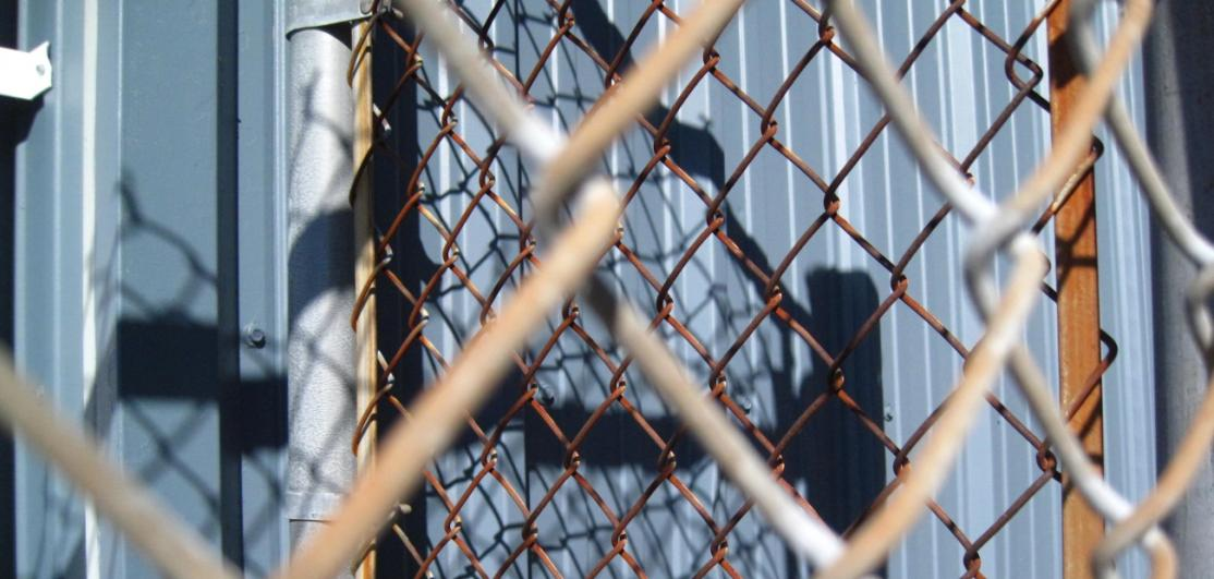 A chain-link fence around a lot
