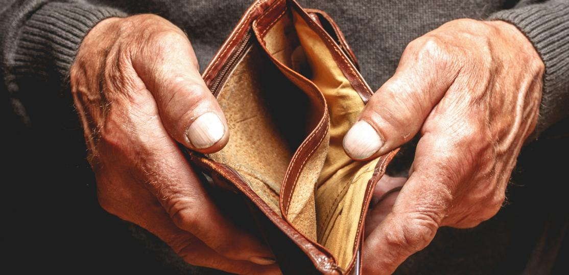 older person holding empty wallet