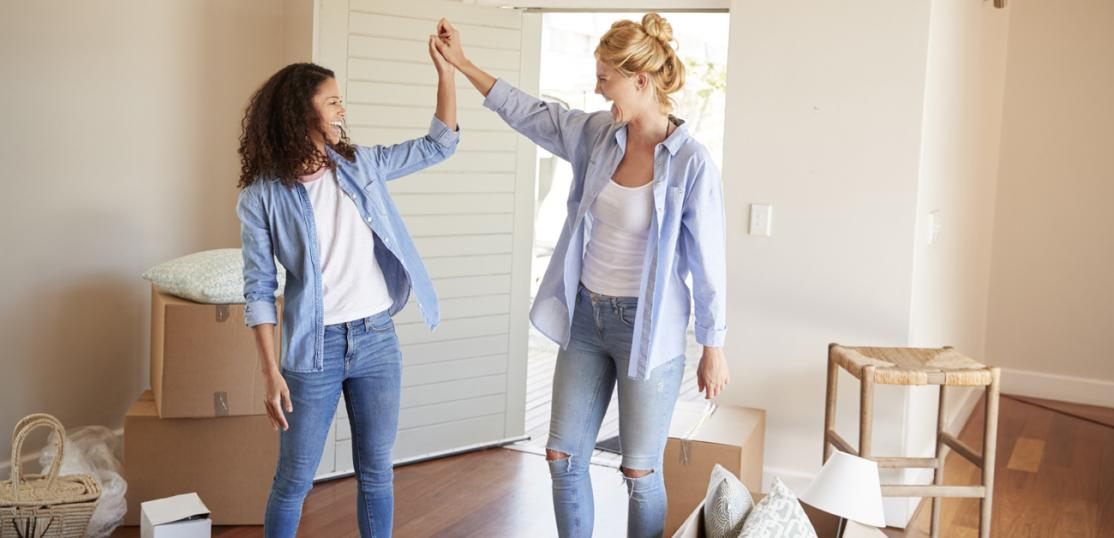 two female friends moving in together