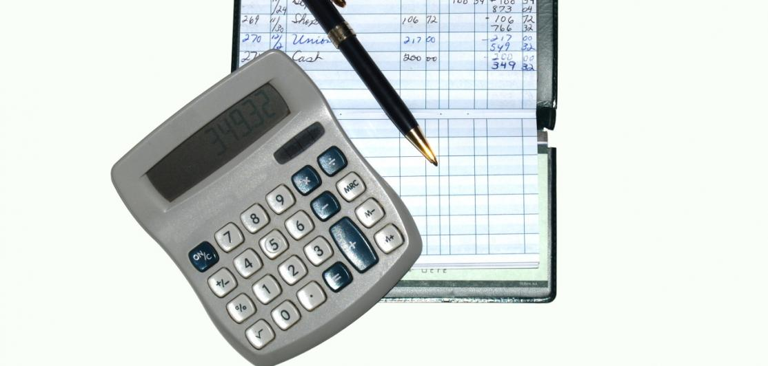 A checkbook and calculator