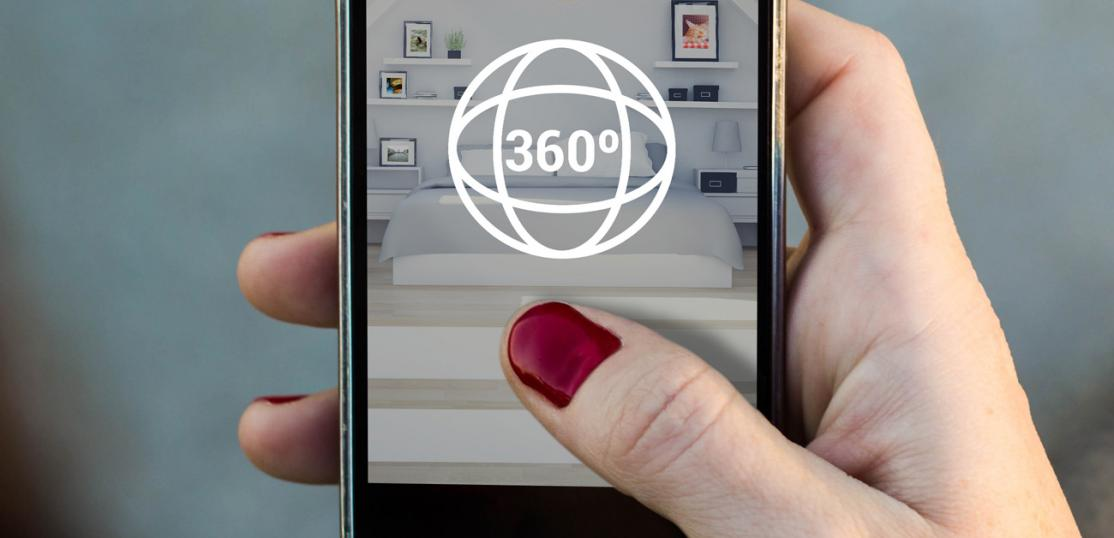 looking at home through virtual tour on phone