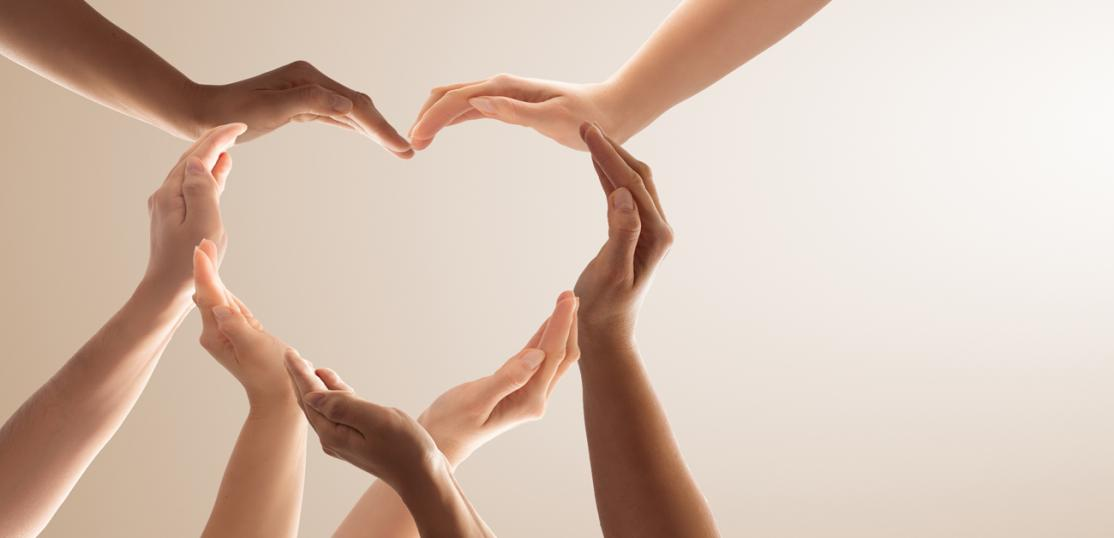 many hands forming heart