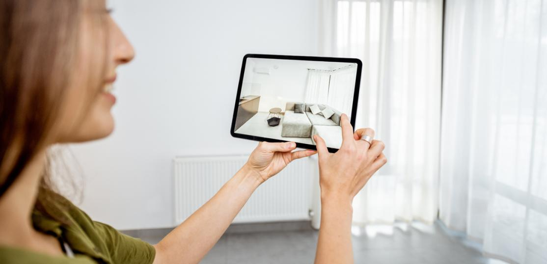 woman looking at 3d view of room on tablet