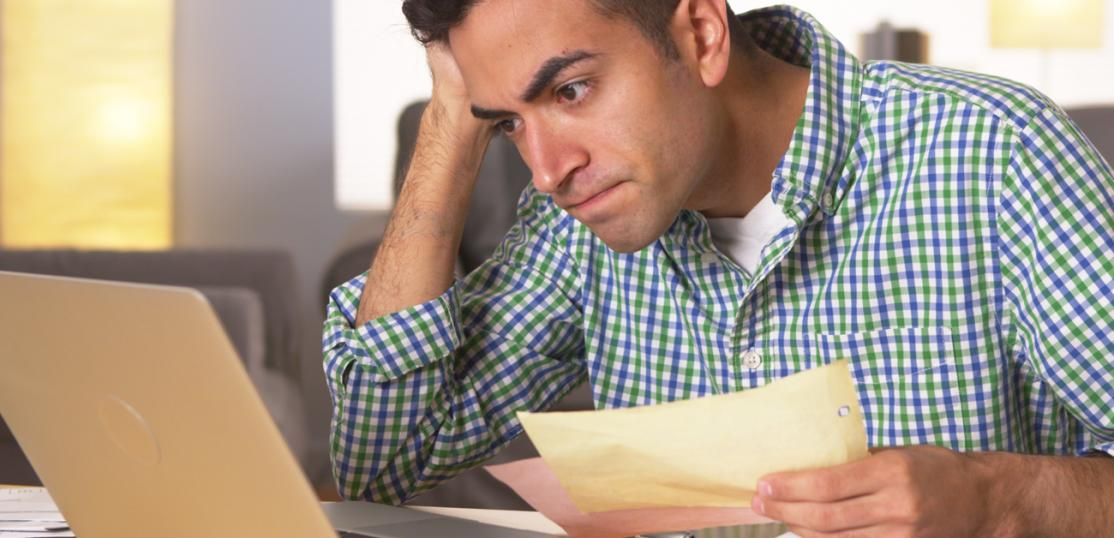 Frustrated man reviewing finances