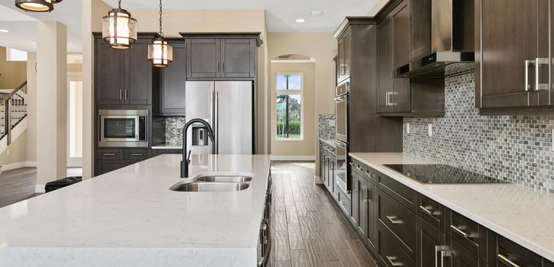 remodeled kitchen with custom lighting and cabinet pulls