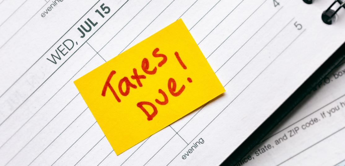 tax reminder sticky note on July 15 in planner