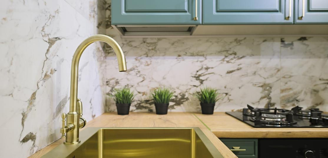 Brass faucet and sink in updated kitchen