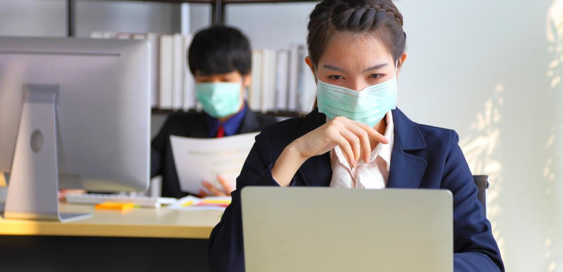 people at office desks with masks on