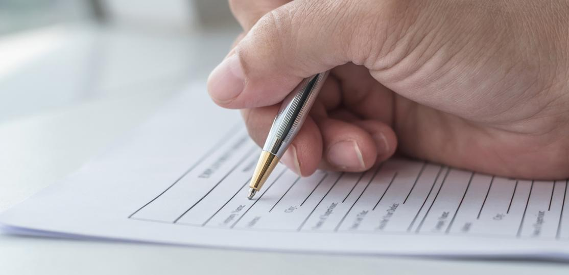 person filling out application