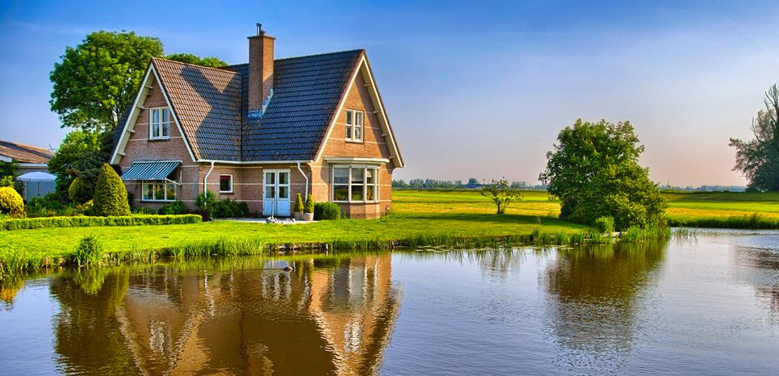 rural home next to pond