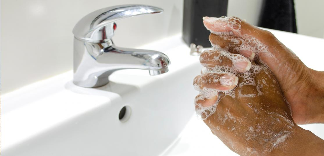 washing hands in sink
