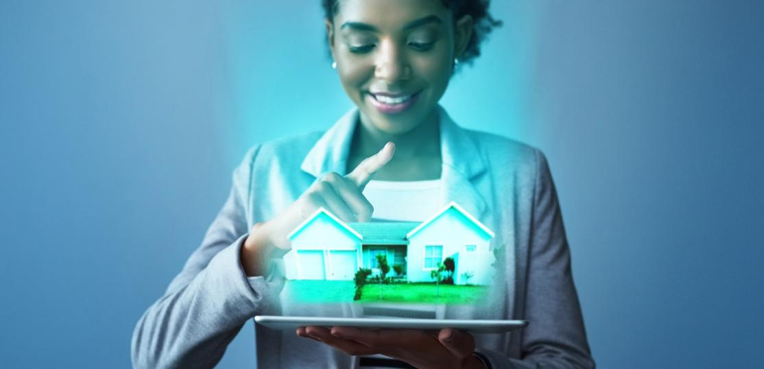 concept photo, woman looking at 3-D house on tablet