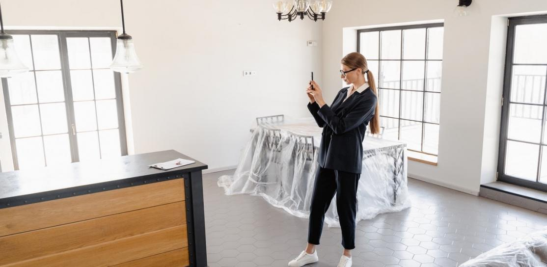 Real estate agent giving virtual tour of house with phone