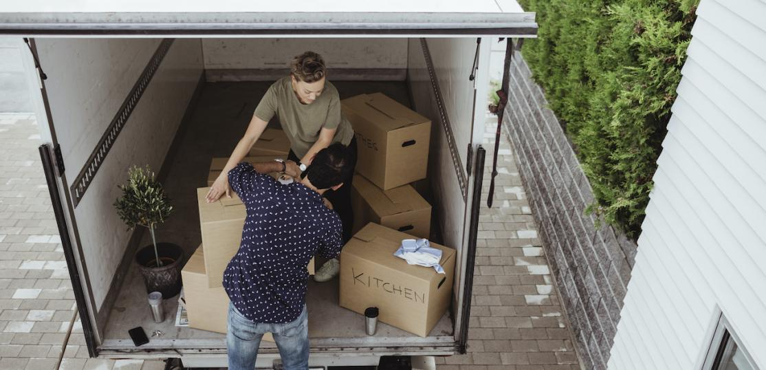 Couple loading boxes in moving truck