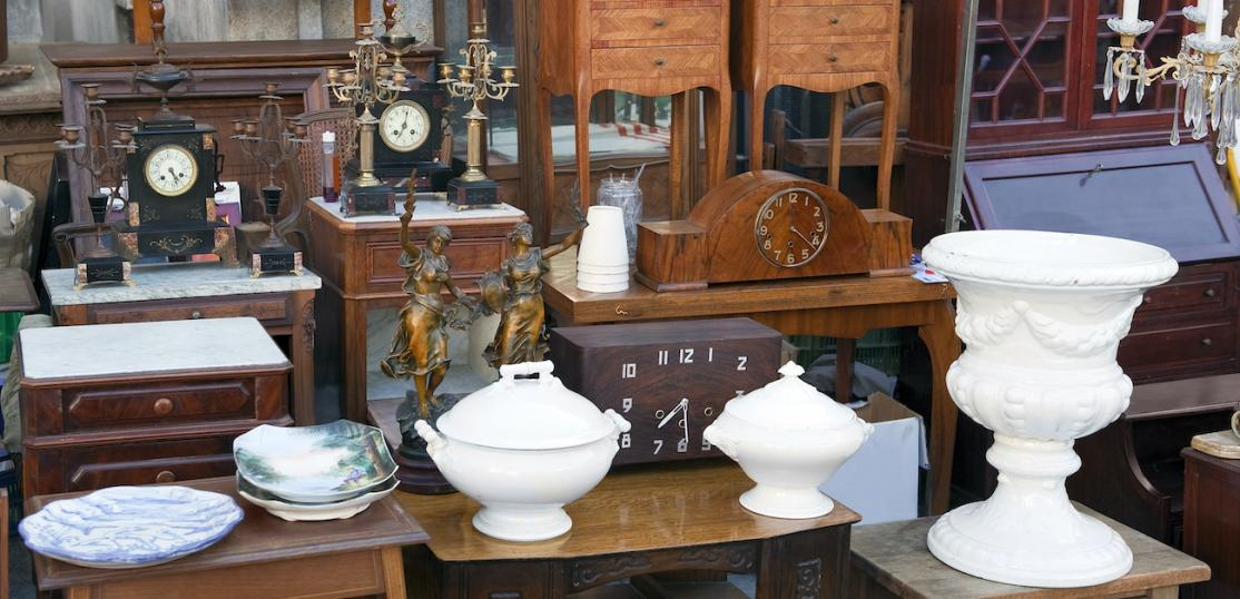 Several antique vases, clocks, and pieces of furniture.