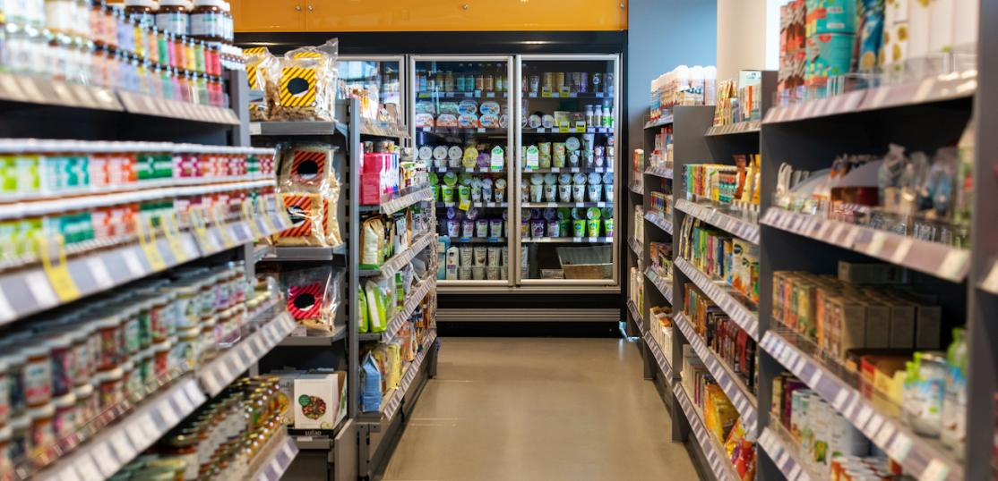 Grocery store aisles with a variety of products