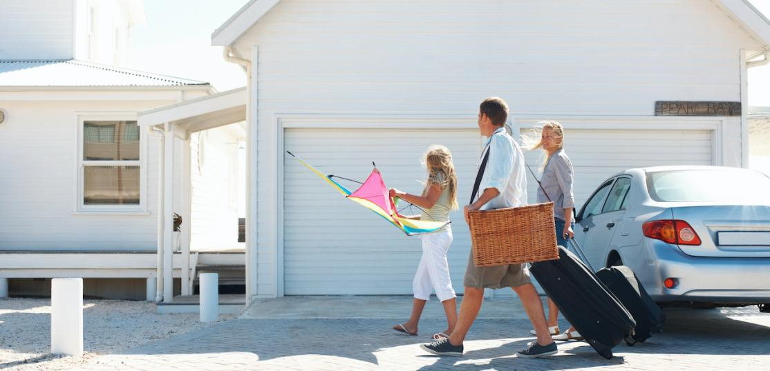 Family walking up to vacation rental house