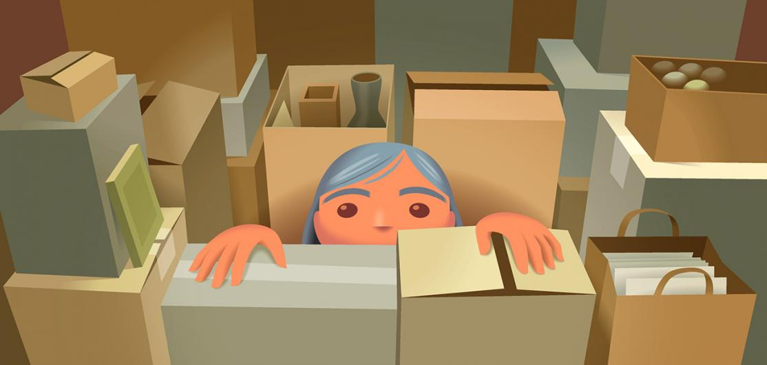 Person peeking out of boxes