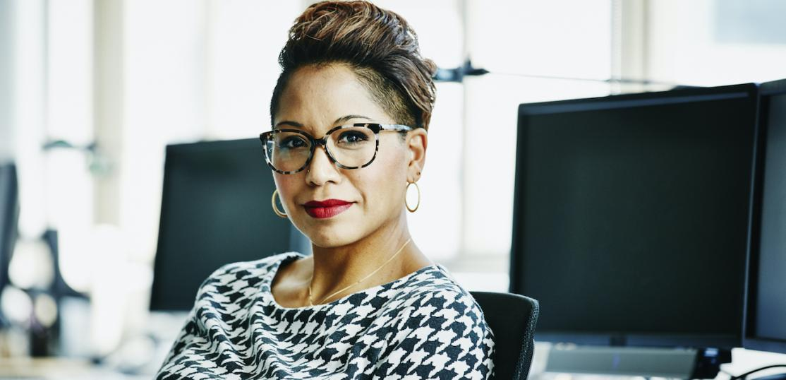 Businesswoman seated at office workstation