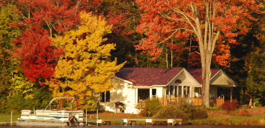 House with colorful trees in fall