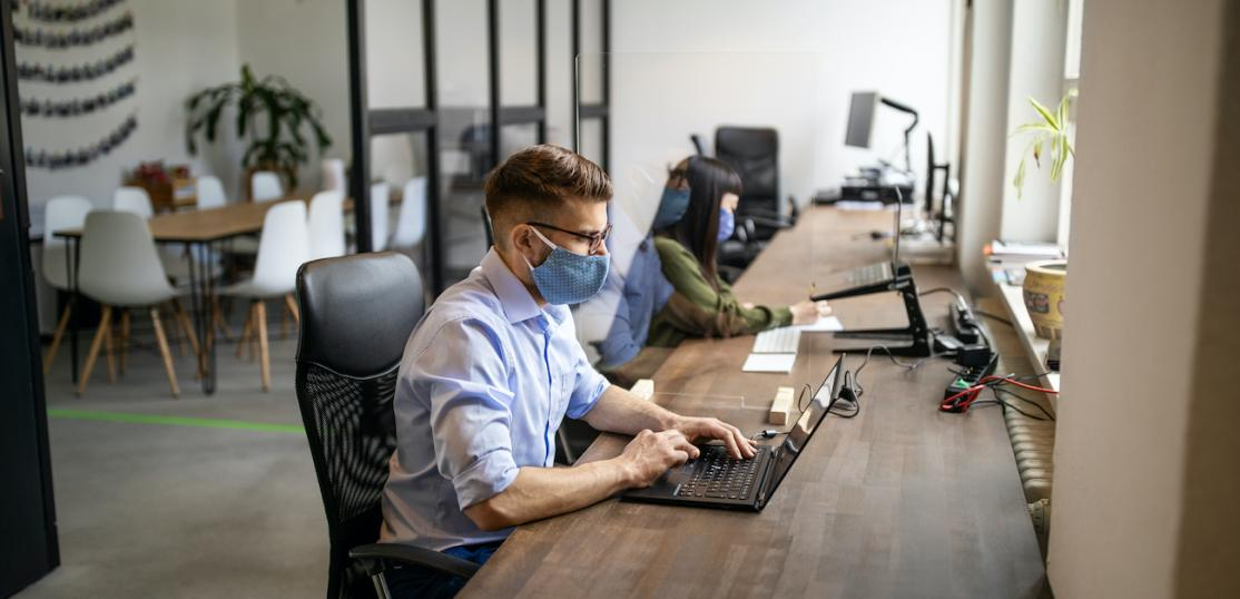 Two people working in co-working space
