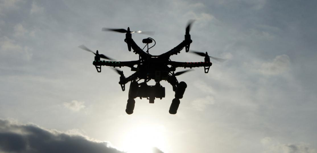 A drone flying with a camera attached