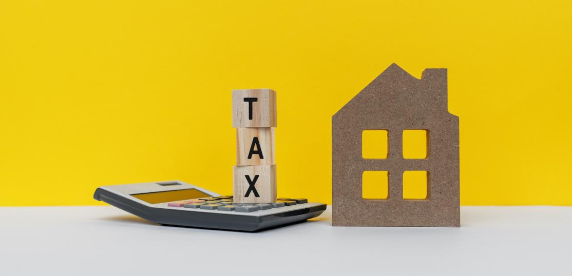 Property tax concept image with model house
