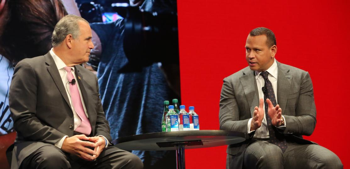 National Association of REALTORS® President Charlie Oppler talking with Alex Rodriguez during the C5 Summit in New York.