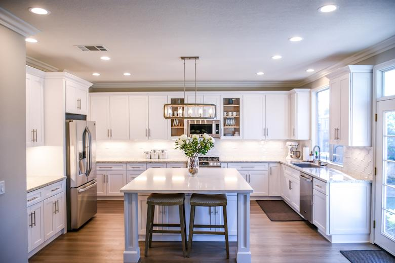 a kitchen with white decor