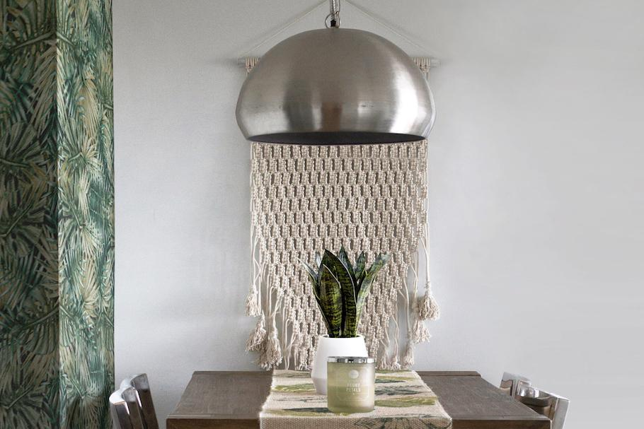 a kitchen with a white macrame wall hanging